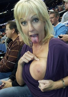 Busty blonde MILF showing her tits at the Super Bowl.