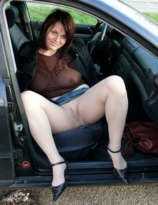 Beautiful lady in sexy pantyhose flashing her pussy