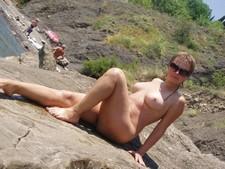 Beauty posing nude on the beach