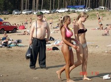 Busty Beach Girl. Some guy snapped a few pics of this lovely, big-chested girl while..