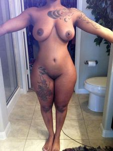 Sexy, curvy and tattooed ebony girlfriend