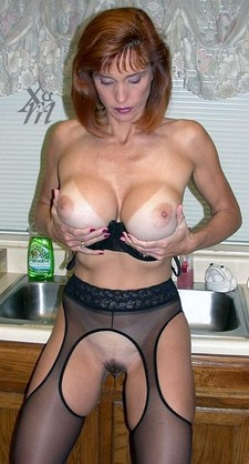 Huge Titted mature Jenn Loves Cum holds her bolt on tits.