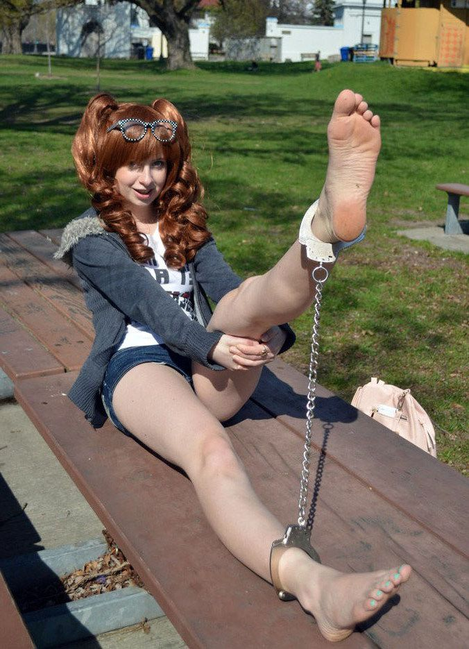 The girl is chained in steel chains