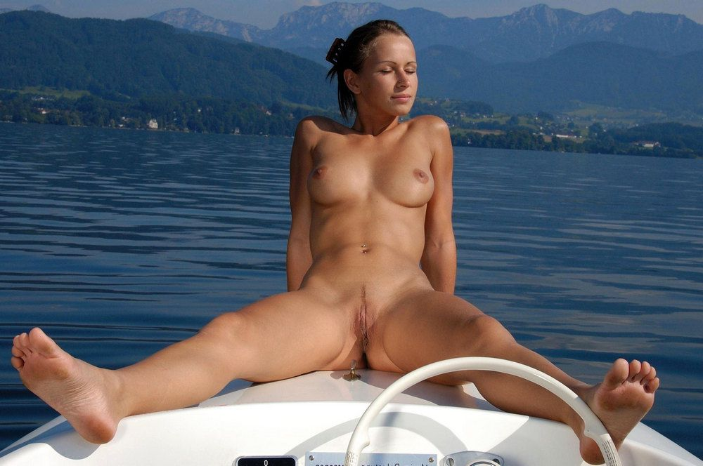 Naked girlfriend on a powerboat, it's all greece