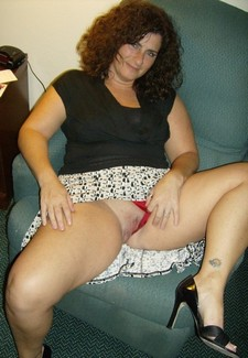 Chubby milf's flashing her pussy in red panties.
