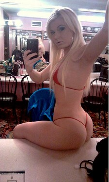 Sexy blonde in red gstring bikini selfie