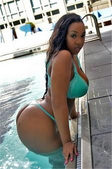 Hot bikini ebony posing with big busty boobs and great big ass in hot thong