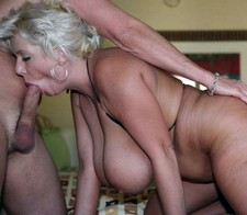Alex Dane looks like a classy, elegant MILF at first. Her long blond hair cascades over..
