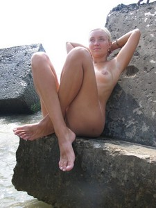 Stunning blonde posing naked on the beach