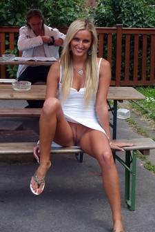 Upskirt no panties mature lady in public park