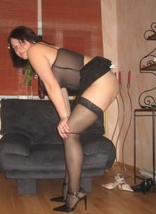 Cute plump brunette in sexy stockings