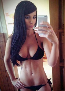 Amateur selfshot of hot bimbo with sexy big breasts and hot big booty in nice bikini