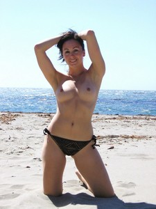 Sexy milf was leaving the beach and voyeur caught her while she was on the way to get..