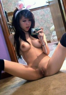 This Asian babe wears bunny ears and sits in any way her man wants her to. He plows her..