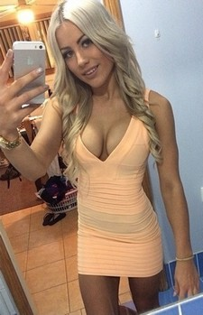 A pretty blonde with big boobs, wearing a skintight blue rubber dress, is gagged and..