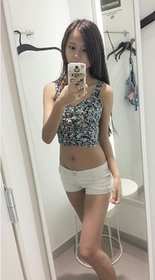 Gorgeous asian teen in sexy clothes downblouse