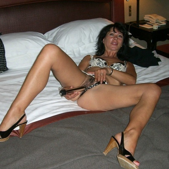 My wife waits for me on our large brown bed, naked to the titties. I come to her, my..
