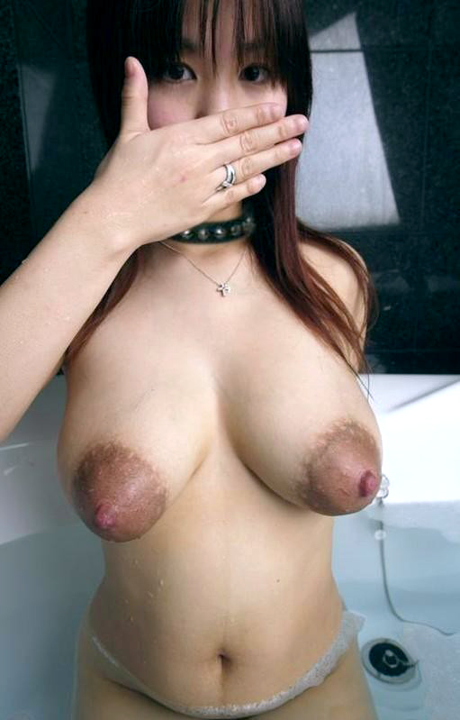 Horny looking Japanese and her nice dark hard nipples