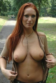 Hot homemade photo with gorgeous redhead mommy.