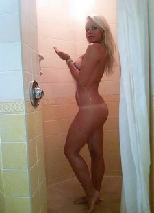 Naughty blonde beauty posing naked in shower
