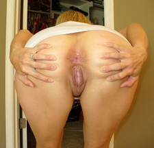Beloved lady spreads buttocks to expose pink wet crack and tight ass hole