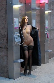 In this sharking video you can see a girl talking in the phone booth and the guy who is..