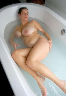Vera loves being in the bath, because it means she can use the showerhead on her clit...
