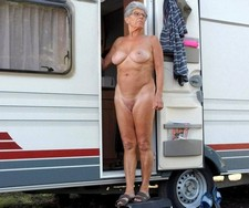 Men and women alike are naked at the nudist camp as I roam with my camera. Everyone is..