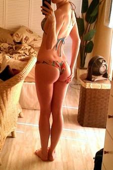 A Leggy Babe Probes Her Holes With A Toy