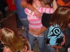 Brunette hottie gets a massive load on the dance floor