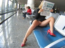 My hot secretary showing pussy at the airport. She's SO HOT!