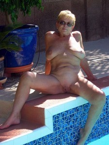Sexy and horny old granny in the pool